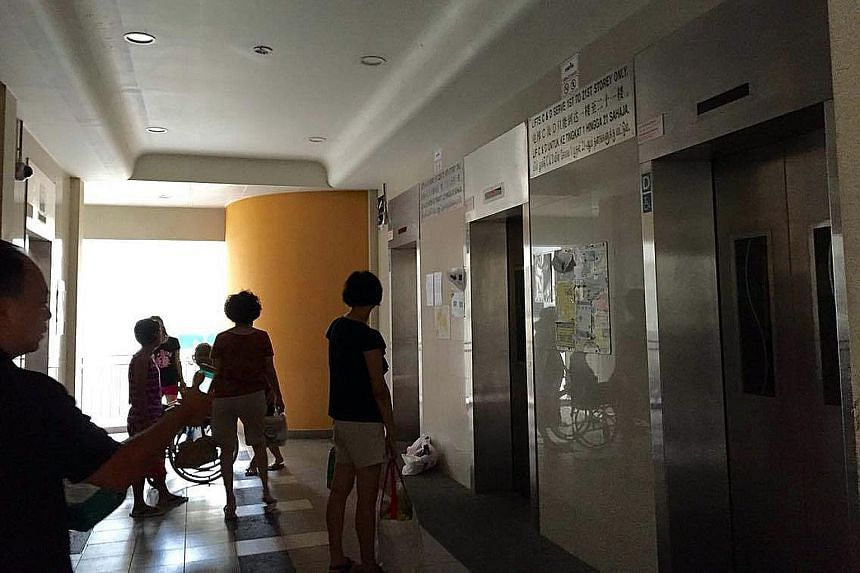 Residents stranded at the lobby of Block 28B Dover Crescent during lunchtime yesterday after the lifts lost power. Some climbed the stairs to their homes. Ms Thia, a resident, said she had noticed the two lifts serving the first and 22nd to 40th floo