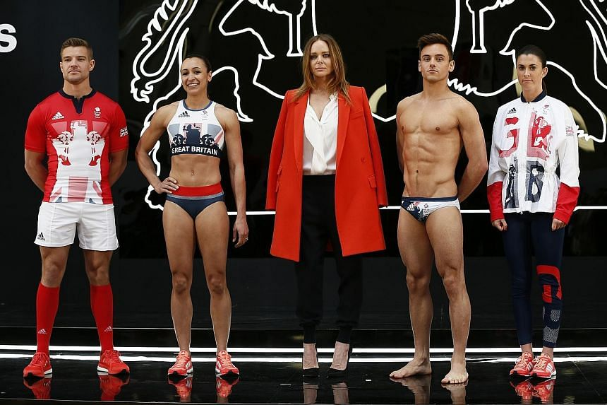 The designs for the British team for this year's Olympics in Rio by Stella McCartney (centre), in collaboration with sports brand Adidas. With her are (from left) rugby captain Tom Mitchell, track-and-field athlete Jessica Ennis-Hill, diver Tom Daley