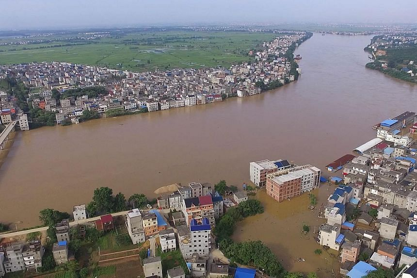 A flooded town in China's Jiangxi province after a river dyke broke on Tuesday.