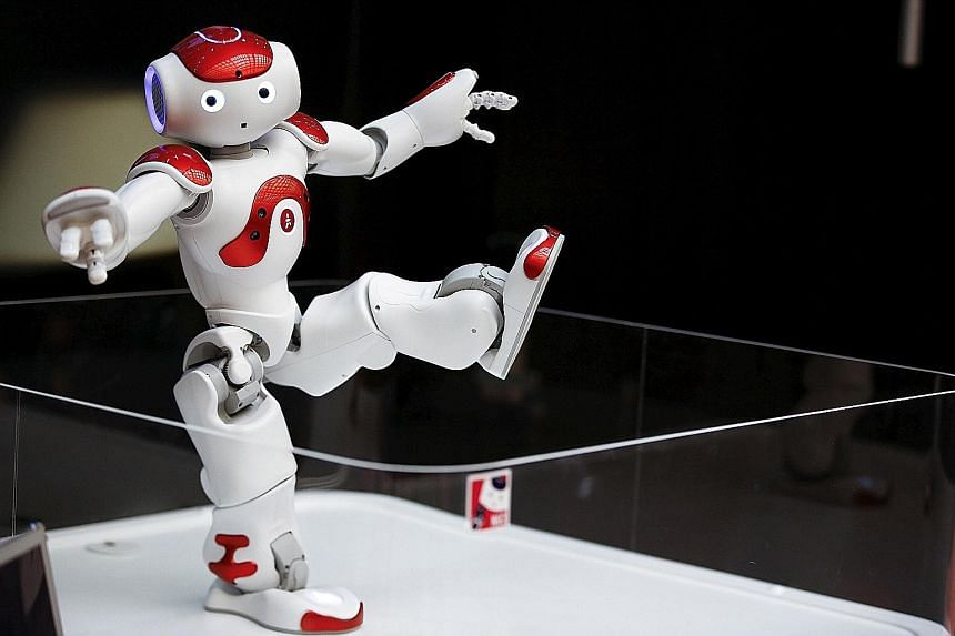 Nao, a humanoid robot, offers basic service information. Robots are being deployed in ever greater numbers in factories and taking on tasks such as personal care or surgery, raising fears over unemployment, wealth inequality and alienation.