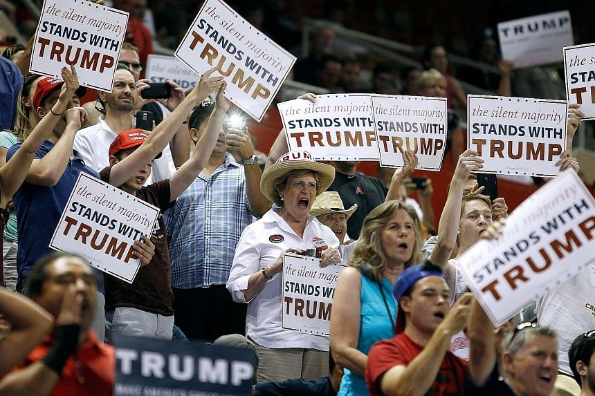 Supporters of Mr Trump cheering as he arrived at a campaign rally in Phoenix, Arizona, last weekend. Mr Trump's campaign finished May with little more than US$1 million in the bank. However, he says he is just getting started as a competitor against