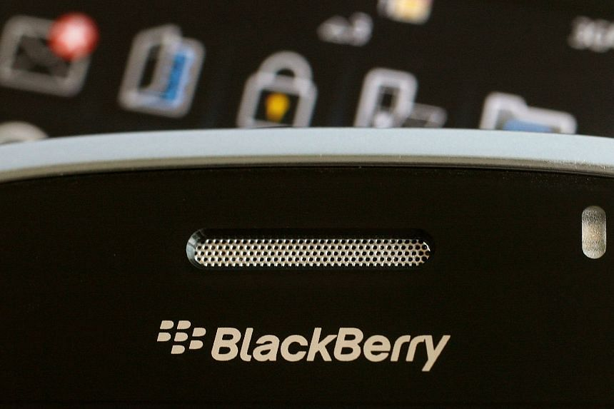 A Blackberry smartphone is displayed in this illustrative photograph.