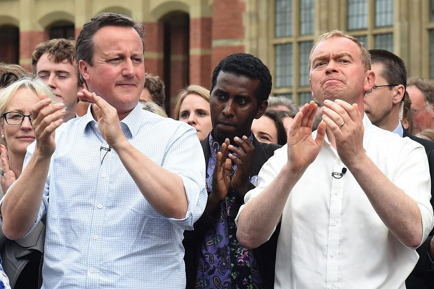British Prime Minister David Cameron (left) stands next to Liberal Democrats leader Tim Farron during a Vote Remain campaign in Birmingham, Britain, on June 22.
