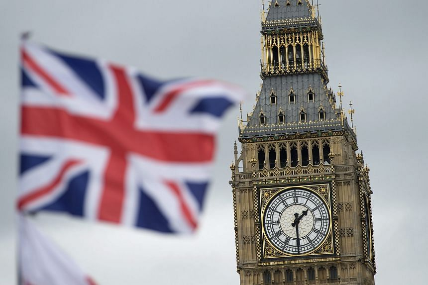A British Union flag flies in in front of the landmark Big Ben, in London, Britain, on June 22.