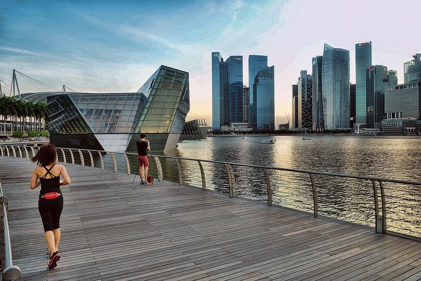 The skyline of Singapore's business district area shot from Marina Bay Sands.