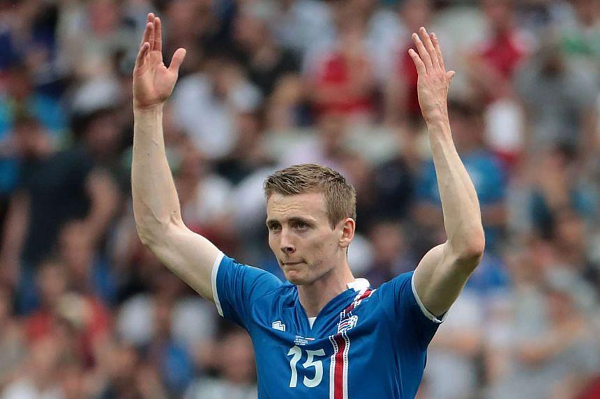 Iceland forward Jon Dadi Bodvarsson celebrates after scoring.
