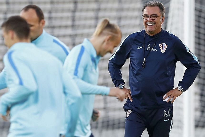 Croatia's coach Ante Cacic (right) attends training with his players.