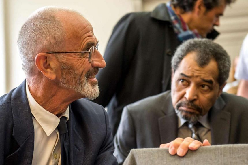 Adelaide's father Michel Lafon (left) speaks with Fabienne Kabou's father, Etienne Kabou, in the courtroom on June 20, 2016.