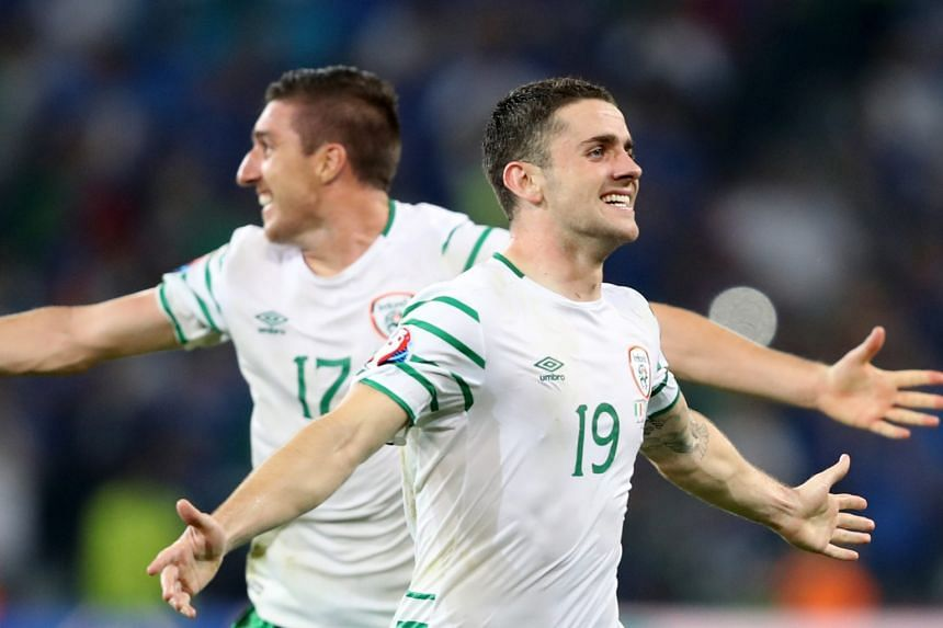 Robbie Brady (right) and Stephen Ward of Ireland celebrate after winning the Uefa Euro 2016 group E  match against Italy.