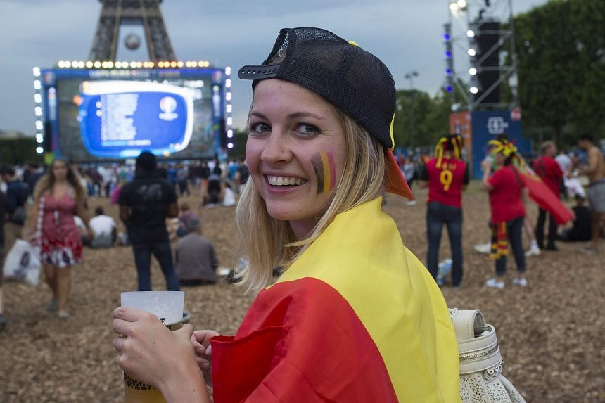 A Belgian fan watching the match against Sweden on a giant screen near the Eiffel Tower on June 22.