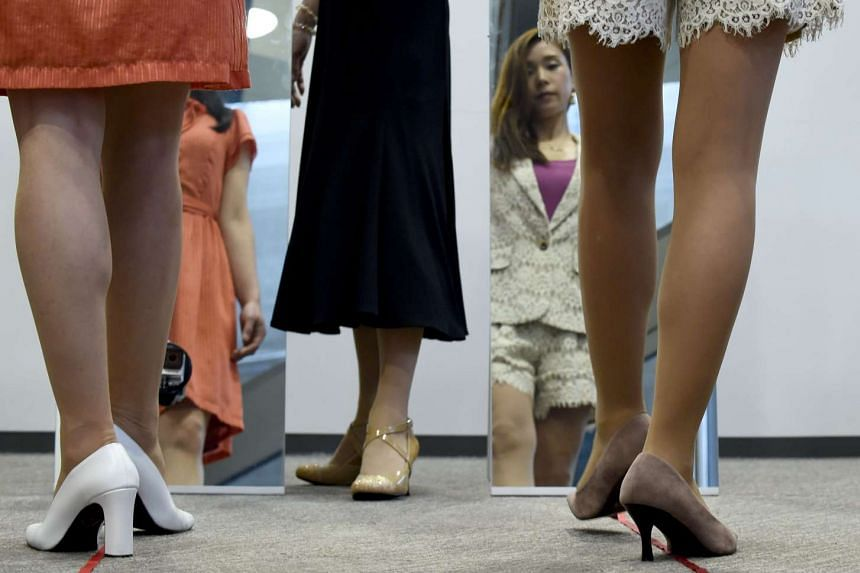 Women receiving a lesson in the use of high heels from the Japan High Heel Association in Tokyo on April 7, 2016.