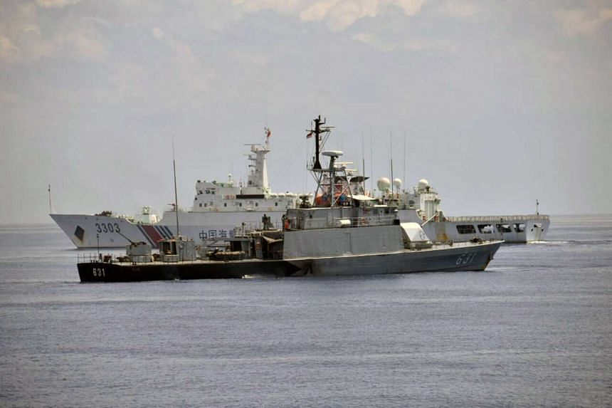 Indonesian navy vessel KRI Todak next to a Chinese Coast Guard vessel while it was trying to detain the fishing boat Han Tan Cou near Natuna Islands, on June 17, 2016.
