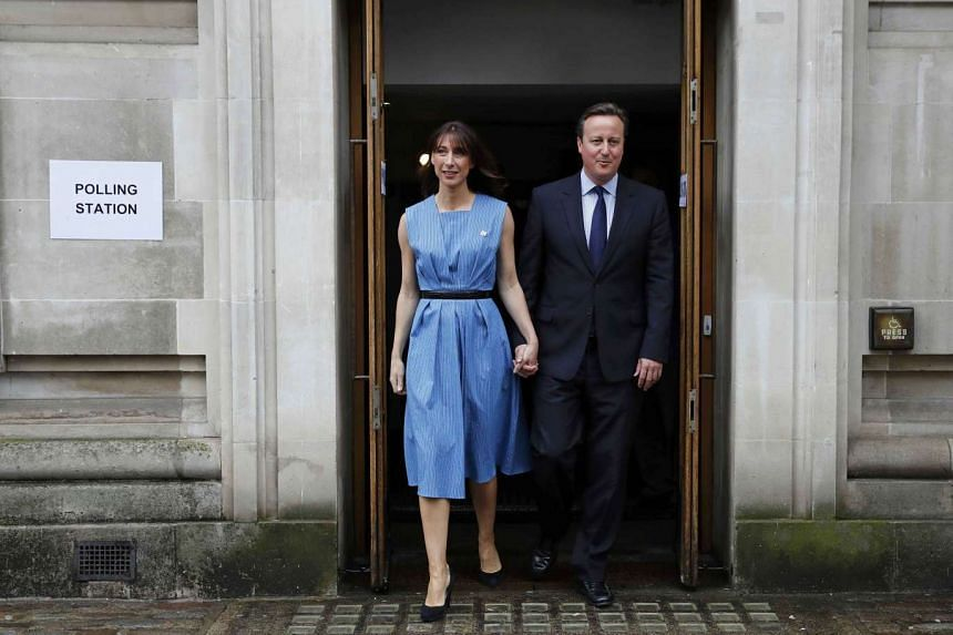 Britain's Prime Minister David Cameron and his wife Samantha leave after voting in the EU referendum, at a polling station in central London on June 23, 2016.