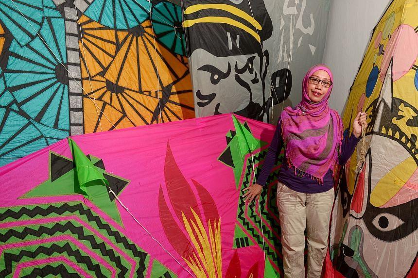 Ms Widiyati posing with some of her kites.