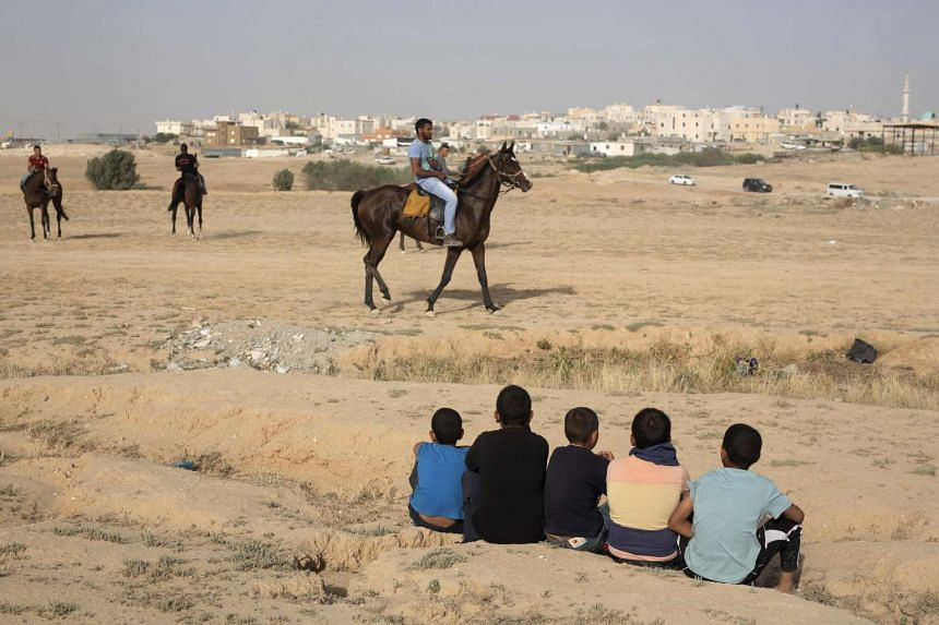 Bedouins riding their horses in the Negev desert in May 2016.