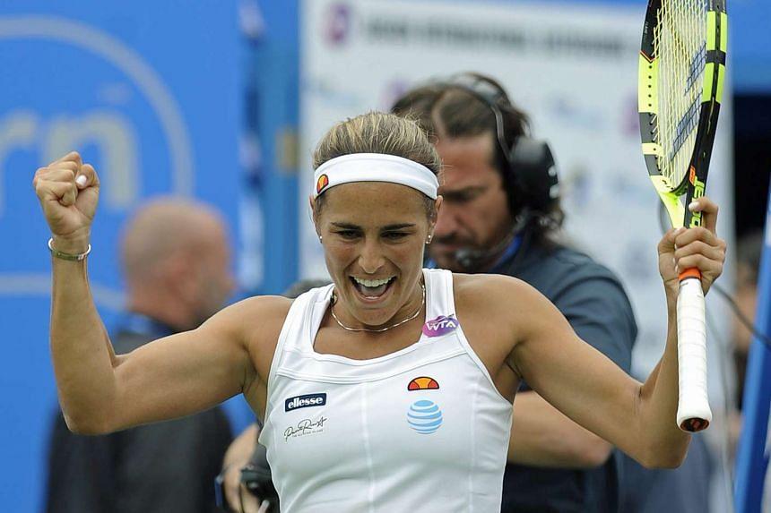 Monica Puig of Puerto Rico celebrates winning against Caroline Wozniacki.