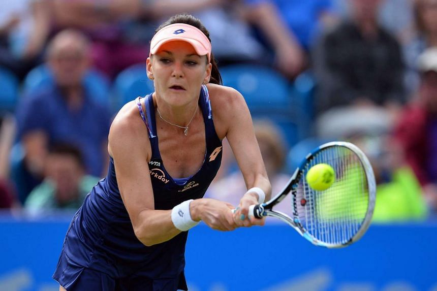 Poland's Agnieska Radwanska returns to Canada's Eugenie Bouchard during their match.