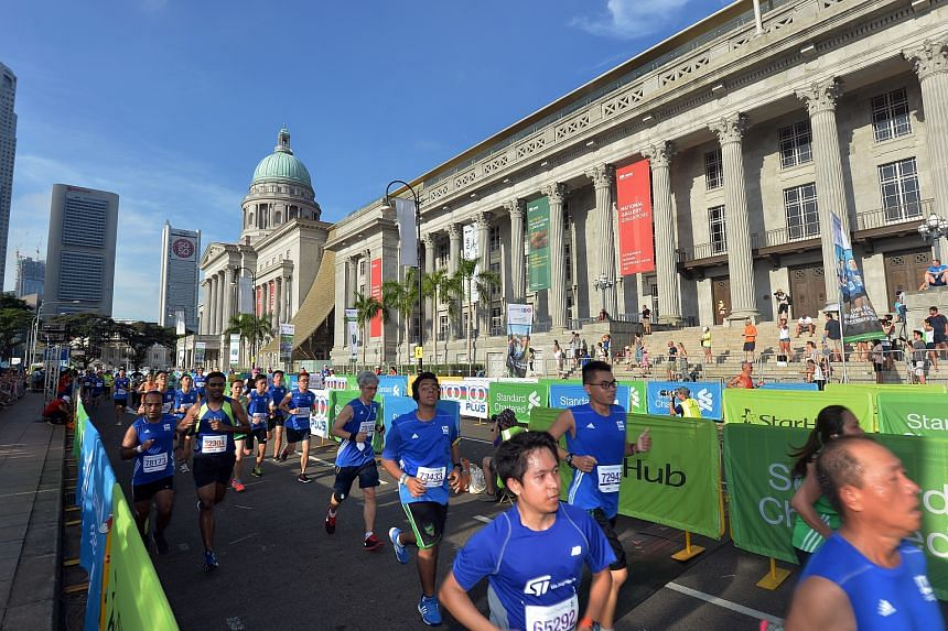 Runners take part in the the 2015 Standard Chartered Marathon Singapore.