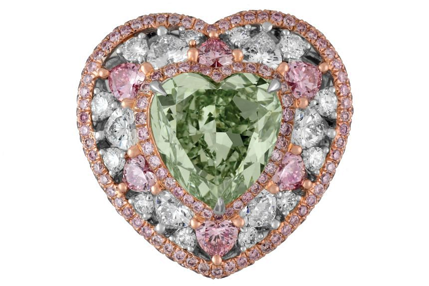 Highlights of the Singapore JewelFest include a necklace featuring a 13.73-carat Afghan emerald with sapphires, tsavorites and diamonds, and the Monarch Mirabella ring (above), which features a 4.9-carat green diamond surrounded by 1.7-carat pink and