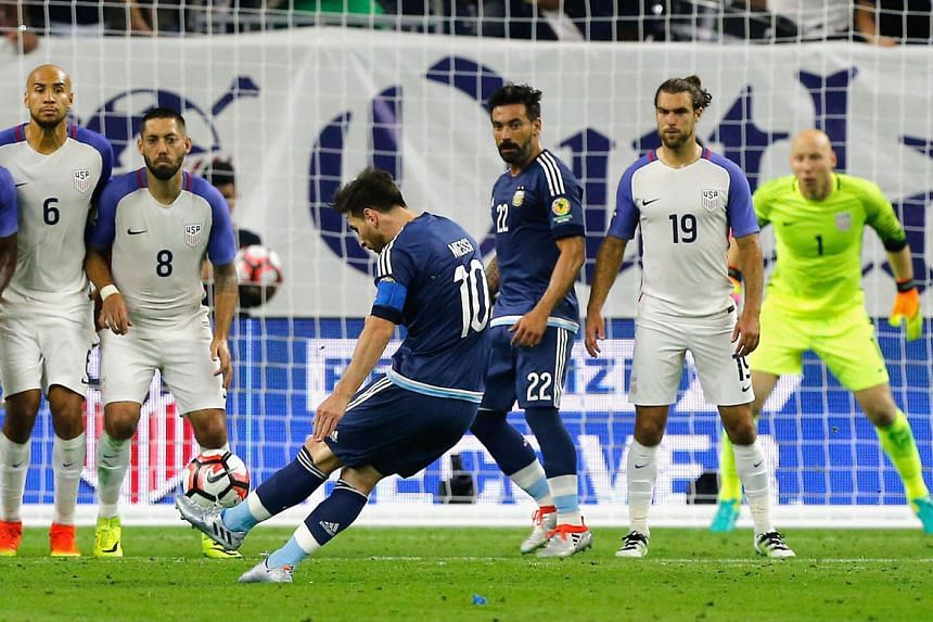 Above: Lionel Messi striking the free kick that doubled his side's lead against the US, setting them on the way to a 4-0 rout.