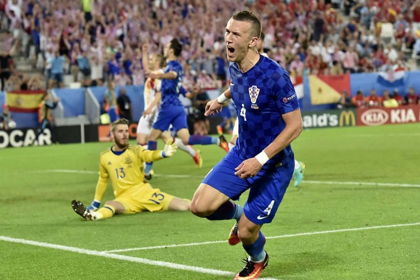 Croatia's Ivan Perisic wheeling away in celebration after beating Spain's David de Gea at his near post. The midfielder's late winner consigned the holders to their first European Championship defeat since 2004.