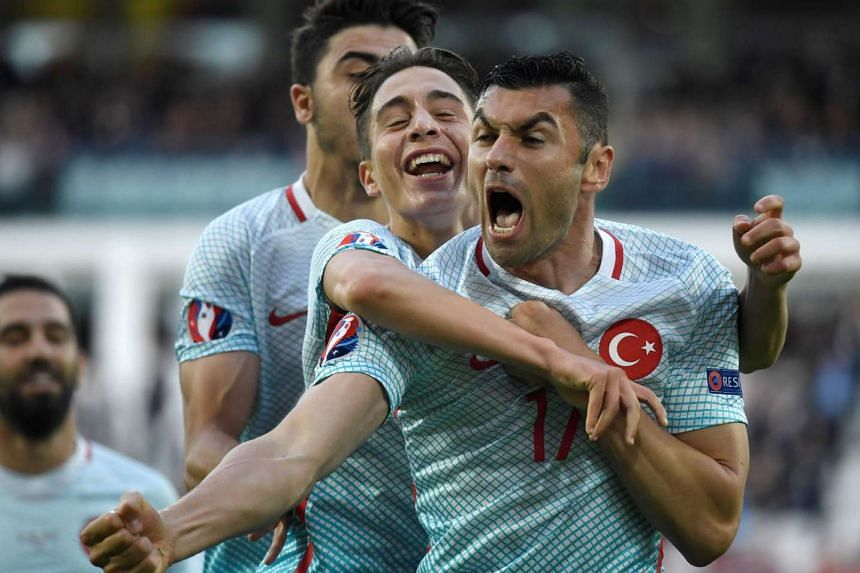 Turkey forward Burak Yilmaz (front) won the Man of the Match award with a tireless display and a goal in their 2-0 win over the Czech Republic.