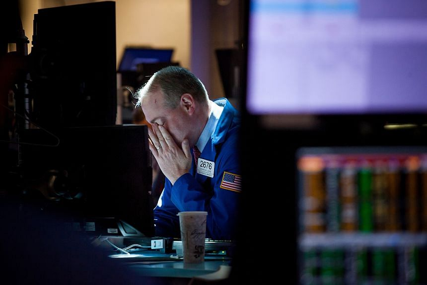 A trader working on the floor of the New York Stock Exchange on June 20.