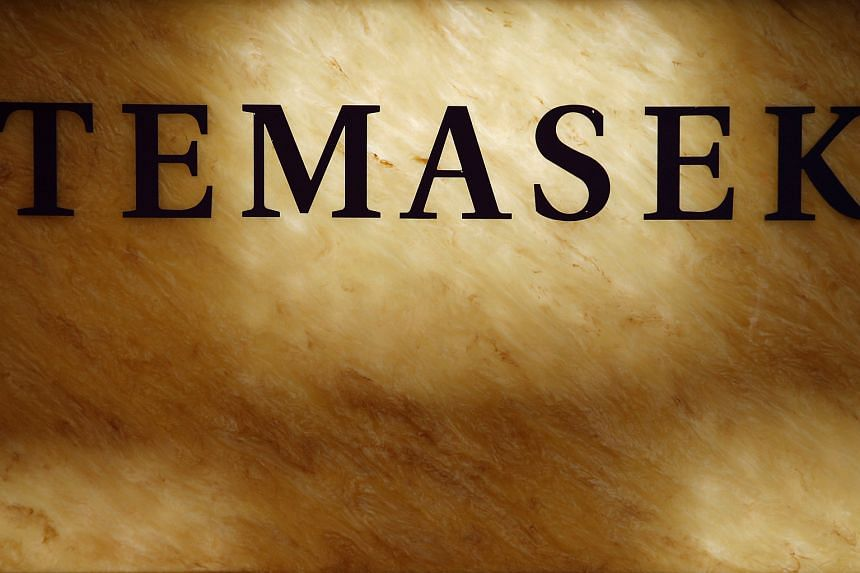 A Temasek Holdings logo is seen at their office in Singapore.