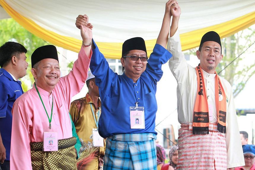 PAS candidate Dr Abdul Rani Osman (left) and candidates from Barisan Nasional and Parti Amanah Negara on Nomination day for Sungai Besar.