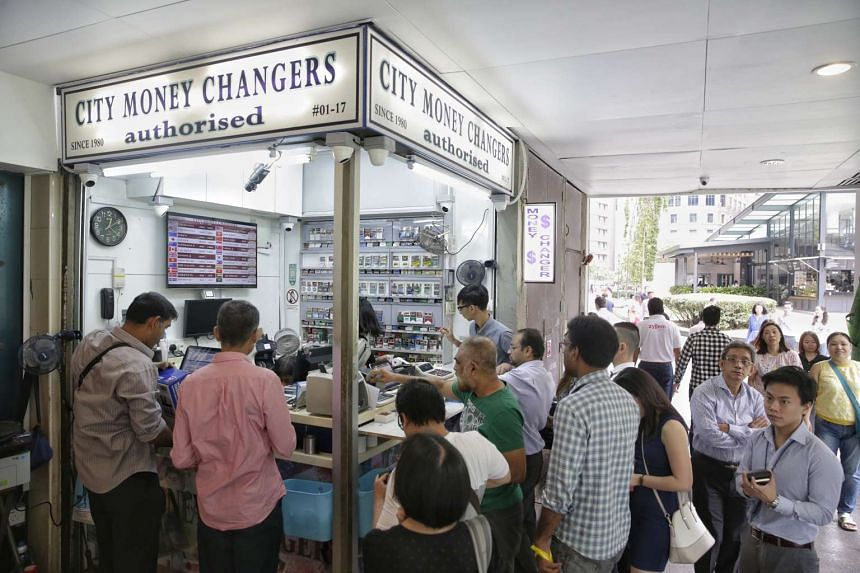 People buying the sterling pound at money changers at The Arcade on June 24, 2016, after Britain voted to exit the European Union.