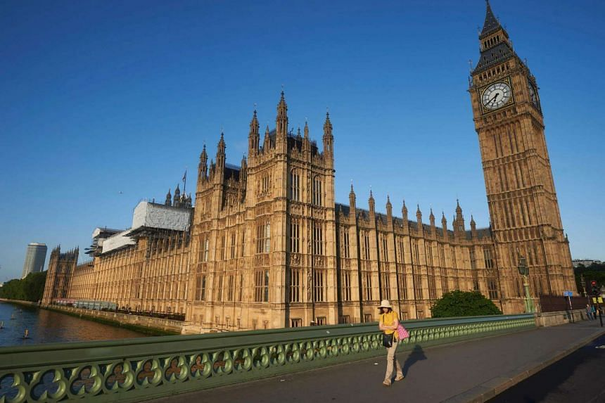 Big Ben and the Houses of Parliament are bathed in morning sunlight in central London on June 24, 2016.