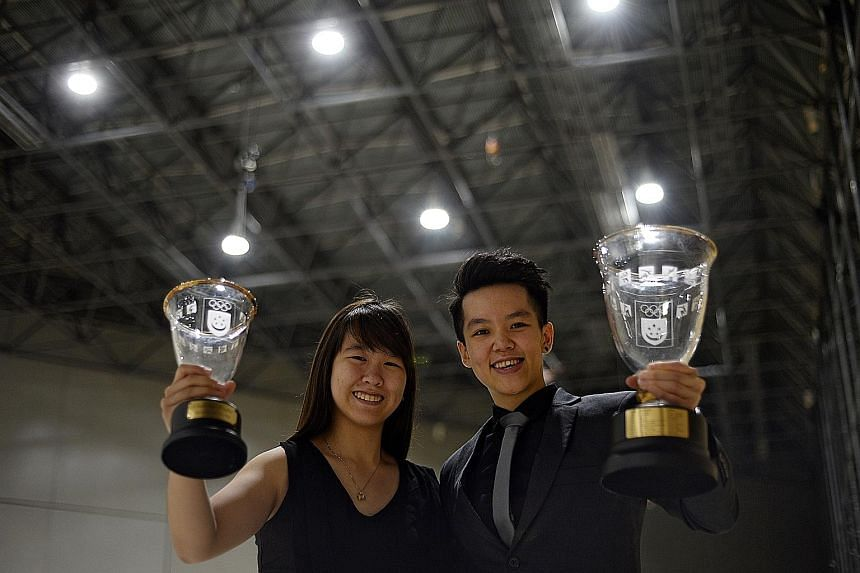Bowlers Joey Yeo (far left) and Shayna Ng (left) won the Sportsgirl of the Year and Sportswoman of the Year awards respectively, capping a big night for keglers at the Singapore Sports Awards last night. ST won the Most Inspiring Sports Story of the