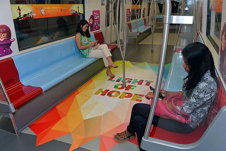 The specially commissioned train (above) is part of a promotion for a mental health awareness run that will take place on Oct 8 at Gardens by the Bay. The train will run on the 18-station Downtown Line until July 22 and be visible to around eight mil