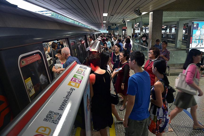 The early morning rush hour at the Ang Mo Kio MRT station yesterday. More than 65,000 commuters benefit every day from the free train ride scheme, which began in 2013 and applies to those who exit 18 MRT stations in the city area on weekdays before 7