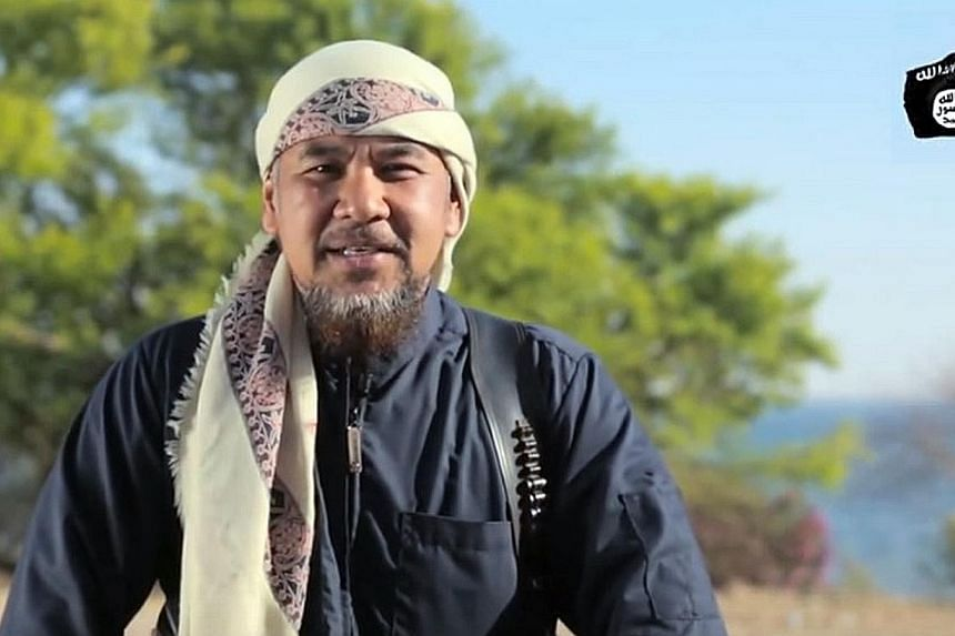 A screengrab from the ISIS propaganda video in which a Malaysian fighter for the militants, identified as Mohd Rafi Udin from Negri Sembilan, urged ISIS supporters in the country to stage attacks. A Filipino and an Indonesian in the video also urged