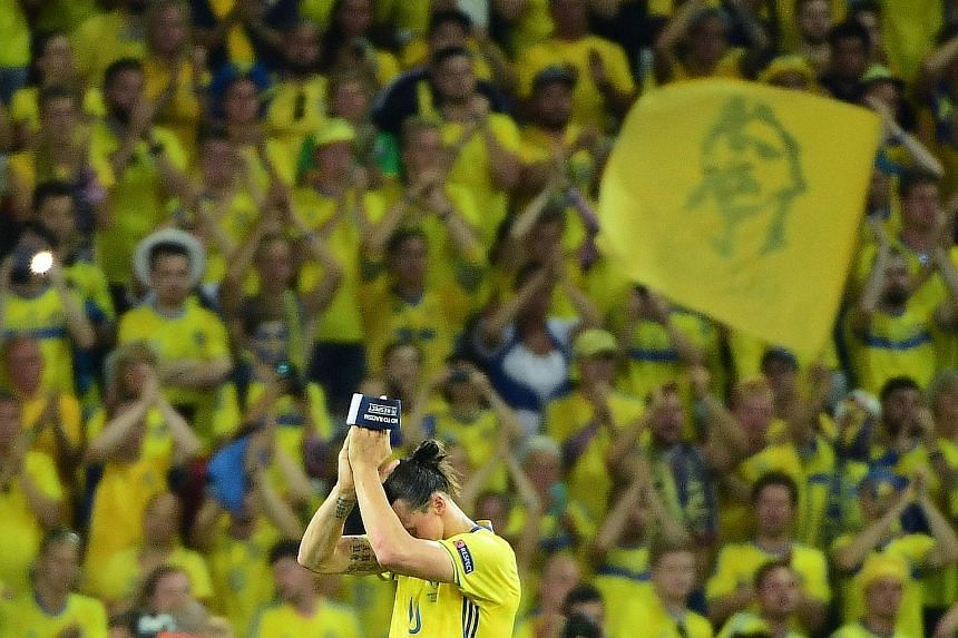 An emotional forward Zlatan Ibrahimovic applauding Swedish fans at the end of the match against Belgium in Nice. He has long been the outsized icon of the side but was unable to take them beyond the last eight of a major tournament.