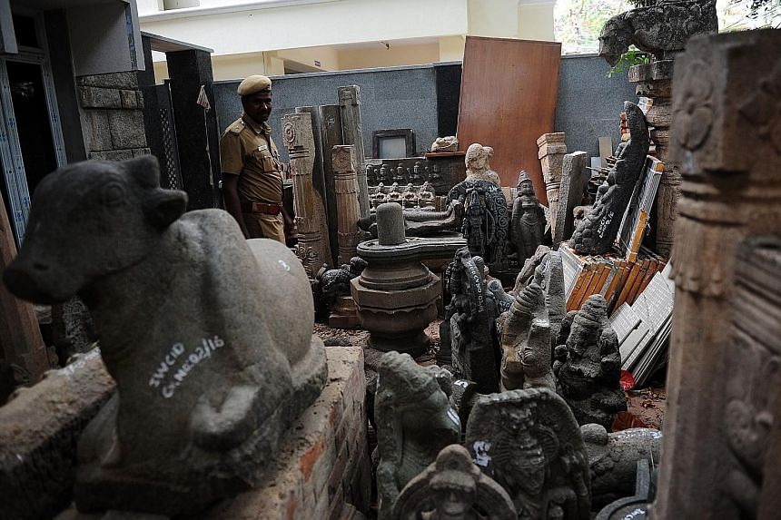 Antique idols and artefacts, believed to be stolen, recovered from art dealer G. Deenadhayalan's home in Chennai. He is suspected of being the leader of a smuggling racket.