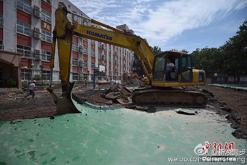 A primary school in Beijing has begun tearing up its running track following reports of students falling sick after using it. China's Ministry of Education has ordered more stringent checks on newly built synthetic tracks.