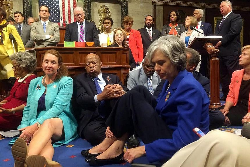Democrats staging a sit-in on the House floor to demand votes on gun-control legislation on Wednesday. The picture was tweeted from the House floor by Representative Katherine Clark (in blue). The Democrats were led in their sit-in by Representative