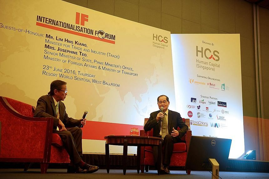 Trade Minister Mr Lim with Banyan Tree Holdings executive chairman Ho Kwon Ping at the HCS forum yesterday.