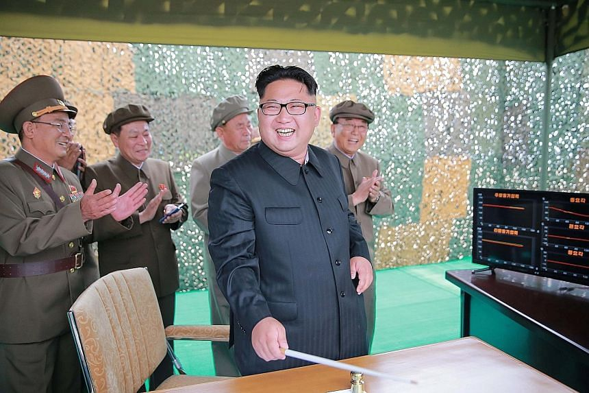 """Mr Kim says that the missile test shows North Korea has """"the sure capability to attack... the Americans in the Pacific operation theatre""""."""