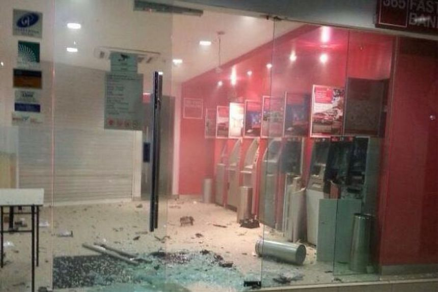 Shattered glass around the ATM that was broken into at a bank in Putatan, Sabah.