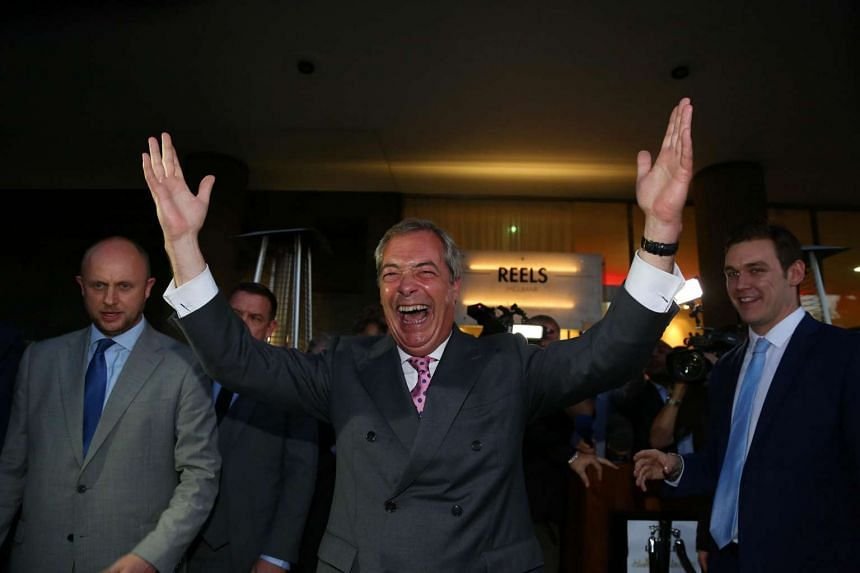 Leader of the United Kingdom Independence Party (UKIP) Nigel Farage (centre) reacts outside the Leave EU referendum party at Millbank Tower on June 24, 2016.