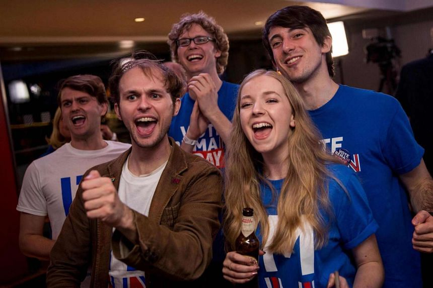 """Supporters of the """"Stronger In"""" Campaign react as results of the EU referendum are announced at a results party at the Royal Festival Hall in London, on June 24, 2016."""