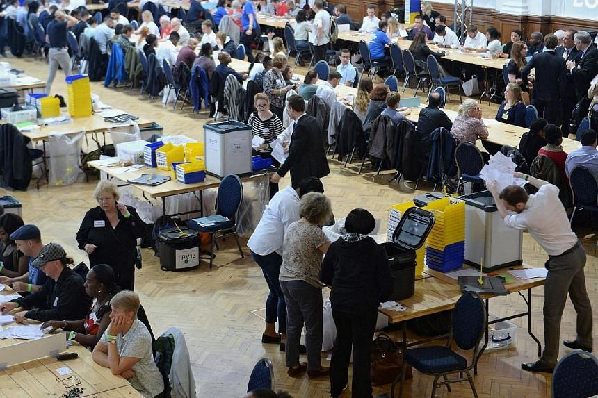 Ballots from the cities of Westminster and London are counted at the Lindley Hall in London on June 23.