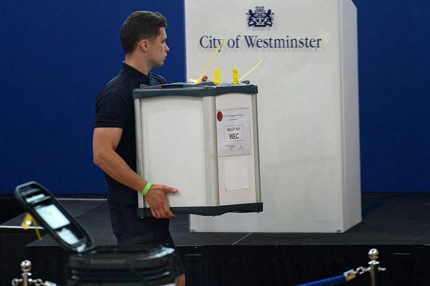 Ballot boxes arrive for the City of Westminster at the Lindley Hall in London on June 23.