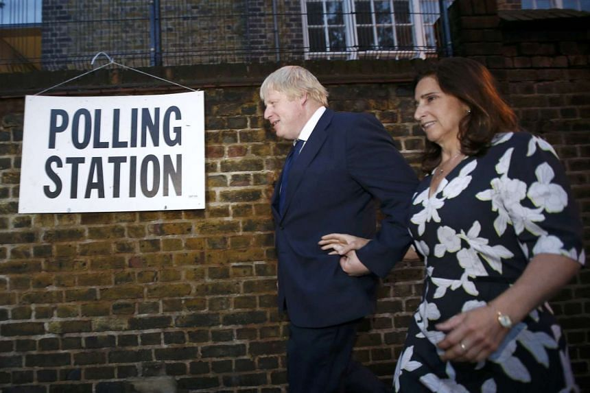 Former London Mayor Boris Johnson and wife Marina Wheeler arrive to vote at a polling station in north London, Britain, late on  June 23, 2016.