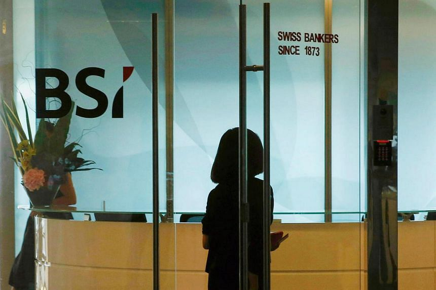 An employee enters the reception area of Swiss bank BSI's office in Singapore on May 24, 2016.