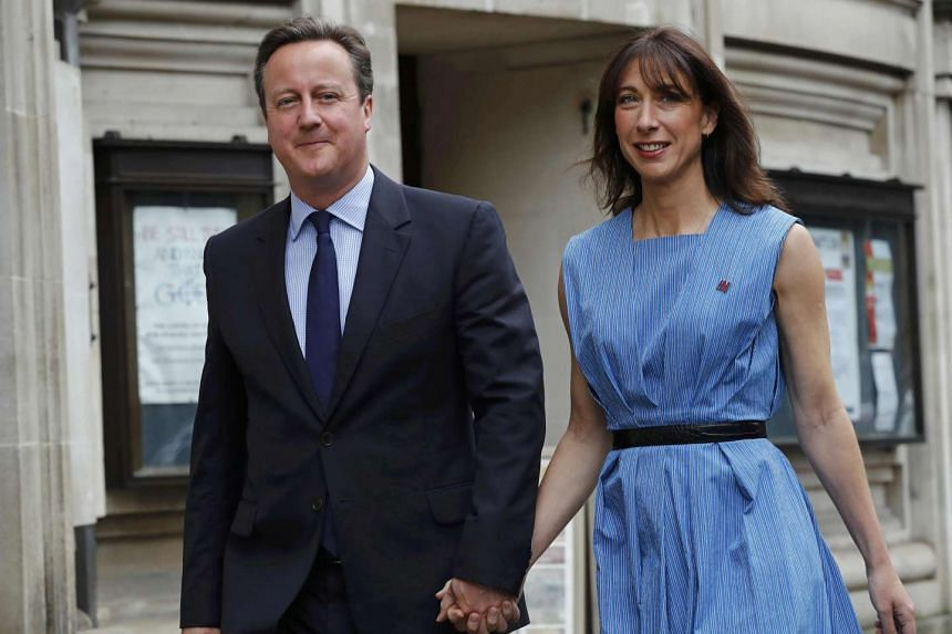 Britain's Prime Minister David Cameron and his wife Samantha arrive to vote at a polling station in central London earlier on June 23, 2016.