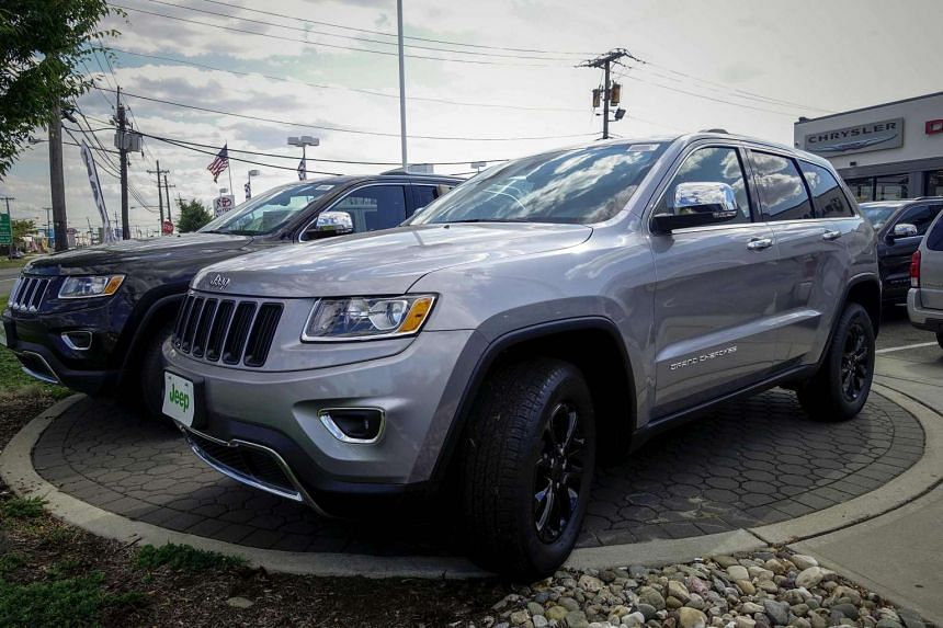 A 2015 Jeep Grand Cherokee is exhibited at a car dealership in Jersey City, New Jersey, on July 24, 2015.